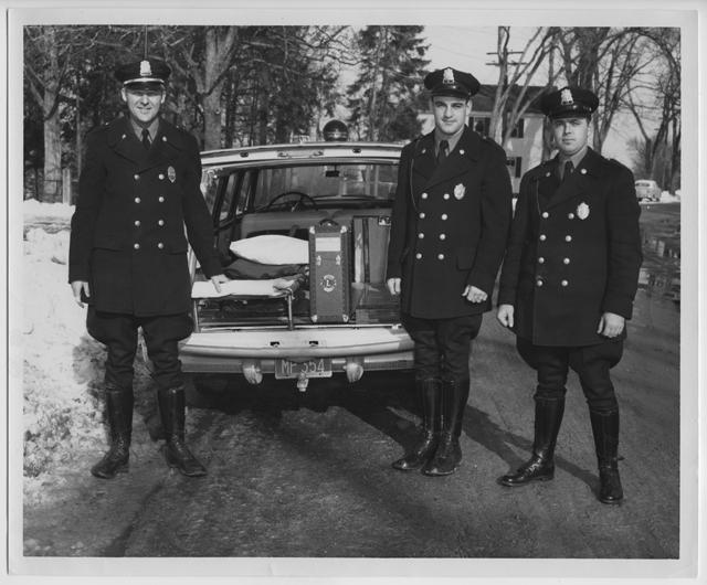 Chief James Goonan, Patrolman Kenneth Cram and Patrolman Donald Elwell, circa 1955. Photo by Loren St. Onge.