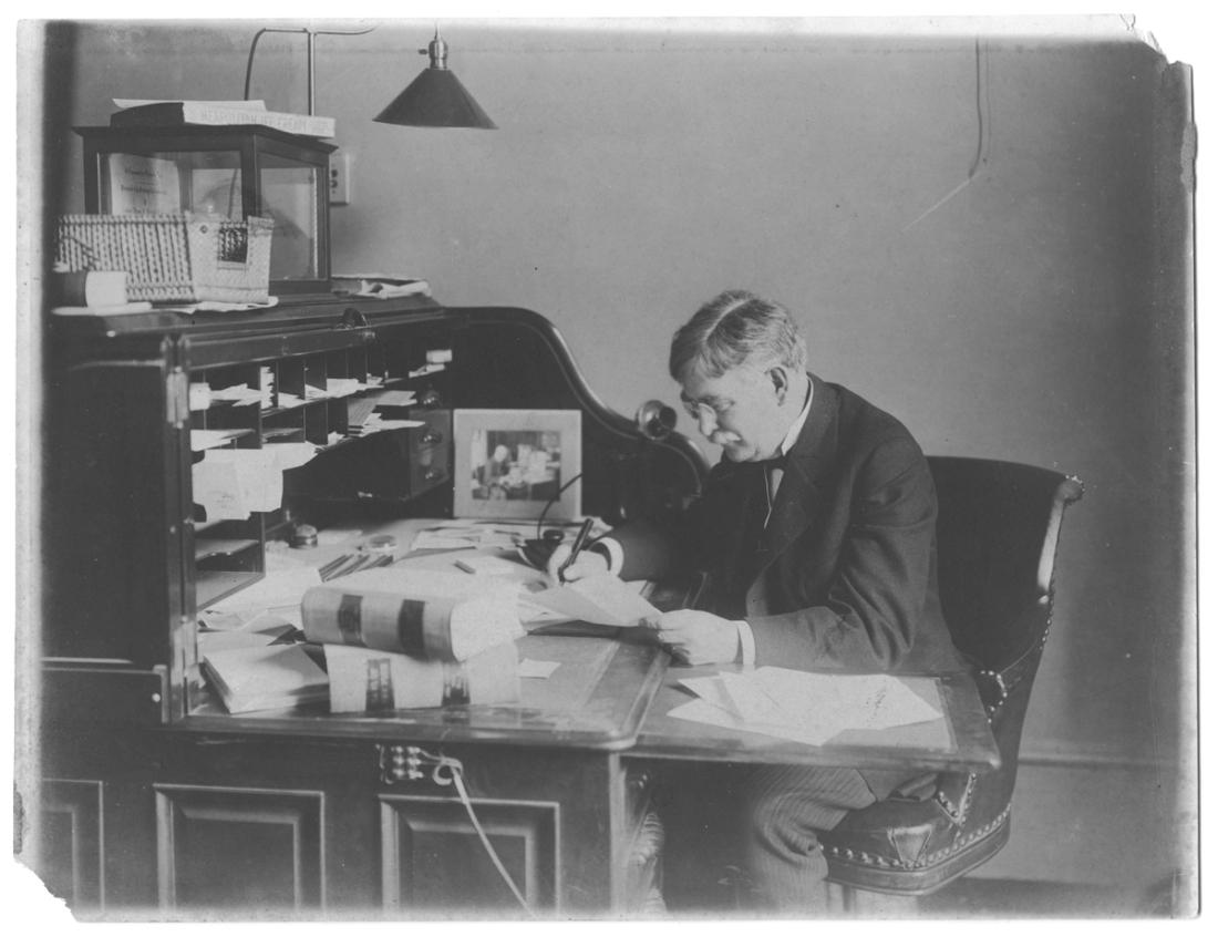 Horatio Adams at his desk, no date