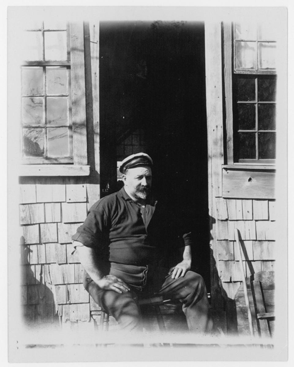Man sitting in a doorway, no date